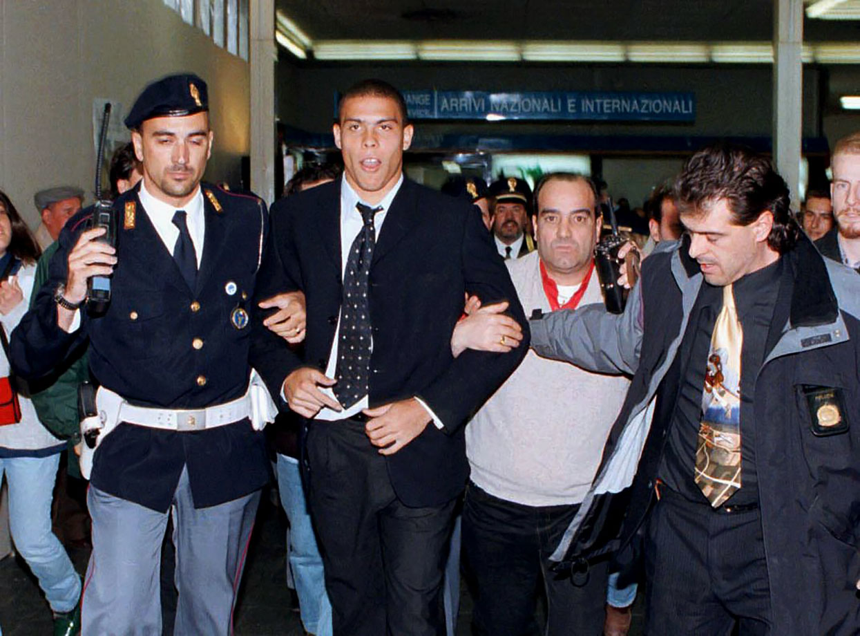 Ronaldo of Barcellona is escorted by Italian policemen out of Pisa's airport in 1997. Barcellona played Fiorentina of Florence in a Champion's League semifinal soccer match held in Florence.