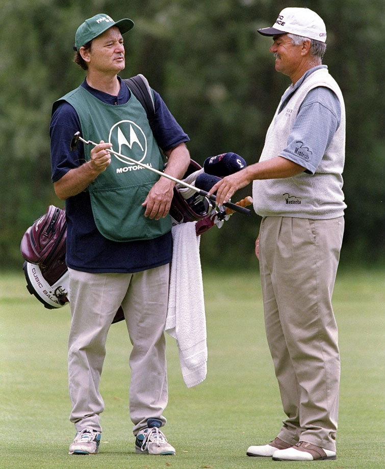 Scott Simpson takes a club from caddie Bill Murray during the Motorola Western Open at the Cog Hill Country Club in Lemont, Ill.