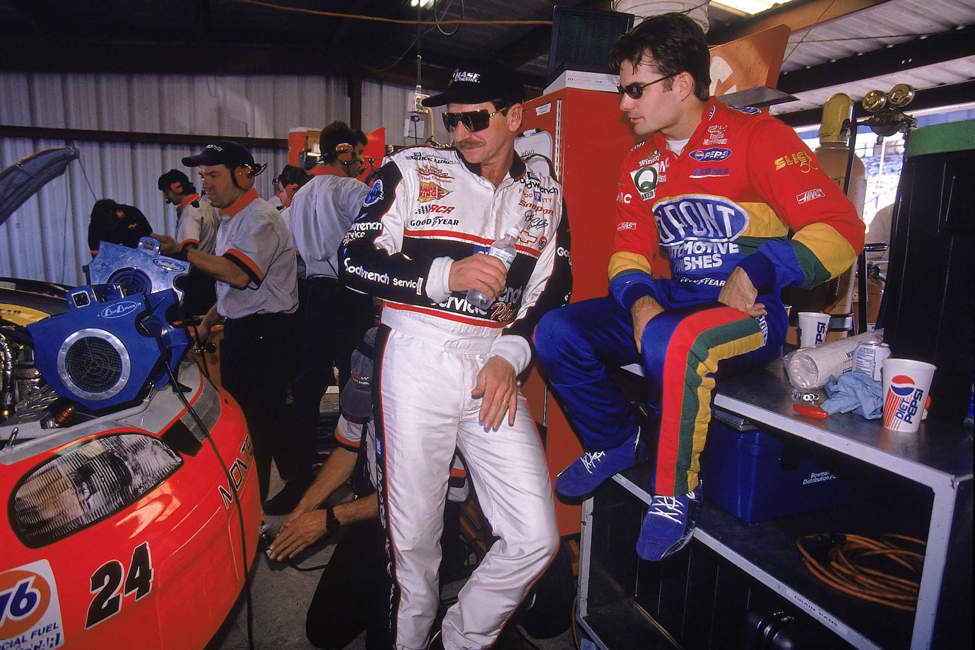 Dale Earnhardt and Jeff Gordon check out Gordon's car in the garage before a race at Richmond International Raceway.