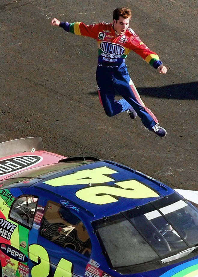 Jeff Gordon jumps from the roof of his car after winning the Winston Cup Championship at the Atlanta Motor Speedway.