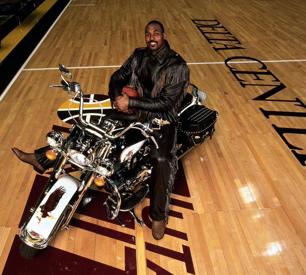 Karl Malone combines his love off motorcycles with his profession here.