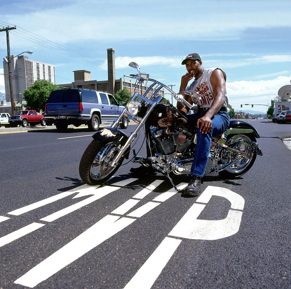 Karl Malone poses for a portrait on his motorcycle.