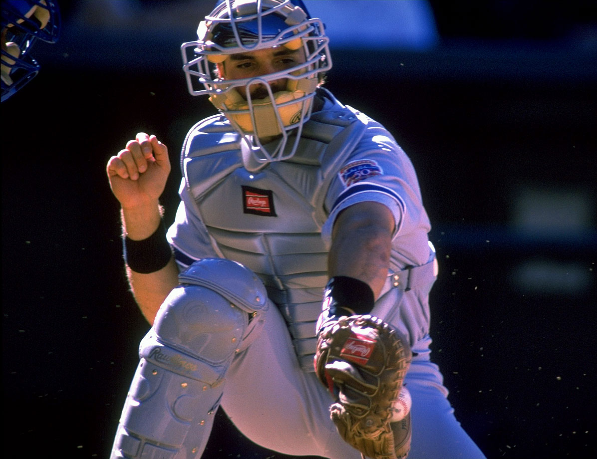 Mike Piazza catches a throw to the plate during a game against the Rockies in Sept. 1997.