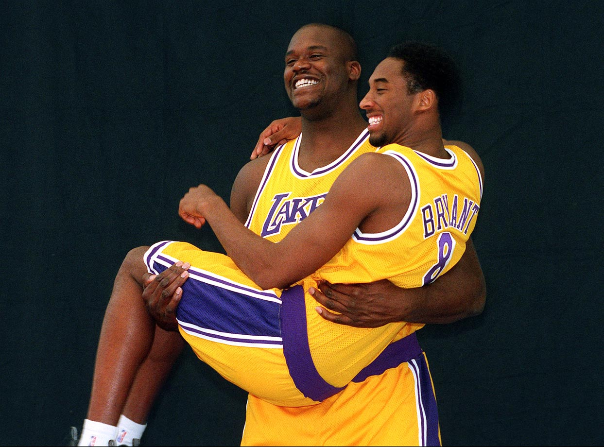 Shaquille carries Bryant during a team media day photo shoot in 1997. Aww, they look so happy!
