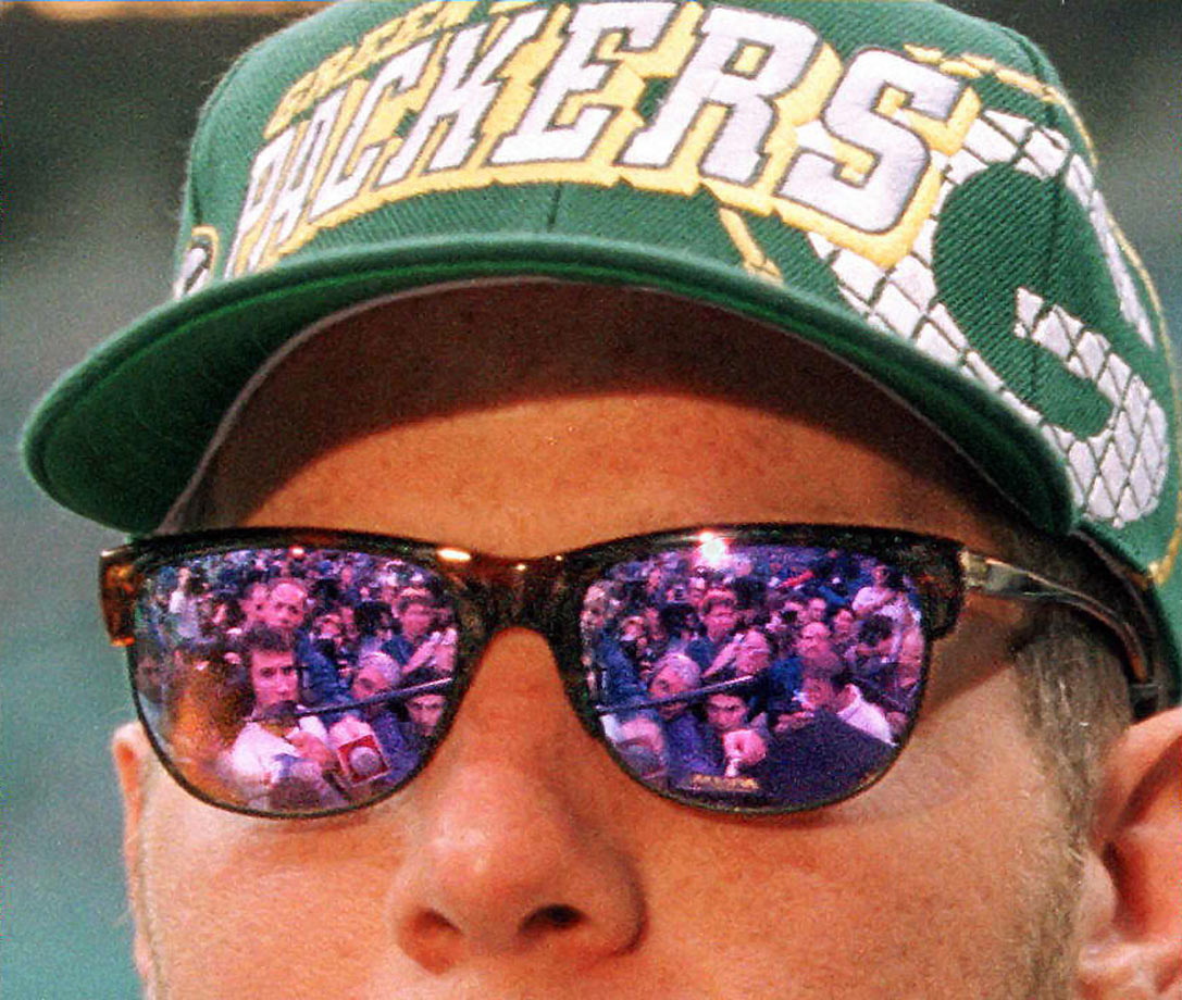 Brett Favre talks to reporters in his shades during Super Bowl XXXI Media Day. Favre threw for 246 yards and two touchdowns in Green Bay's 35-21 win over New England.