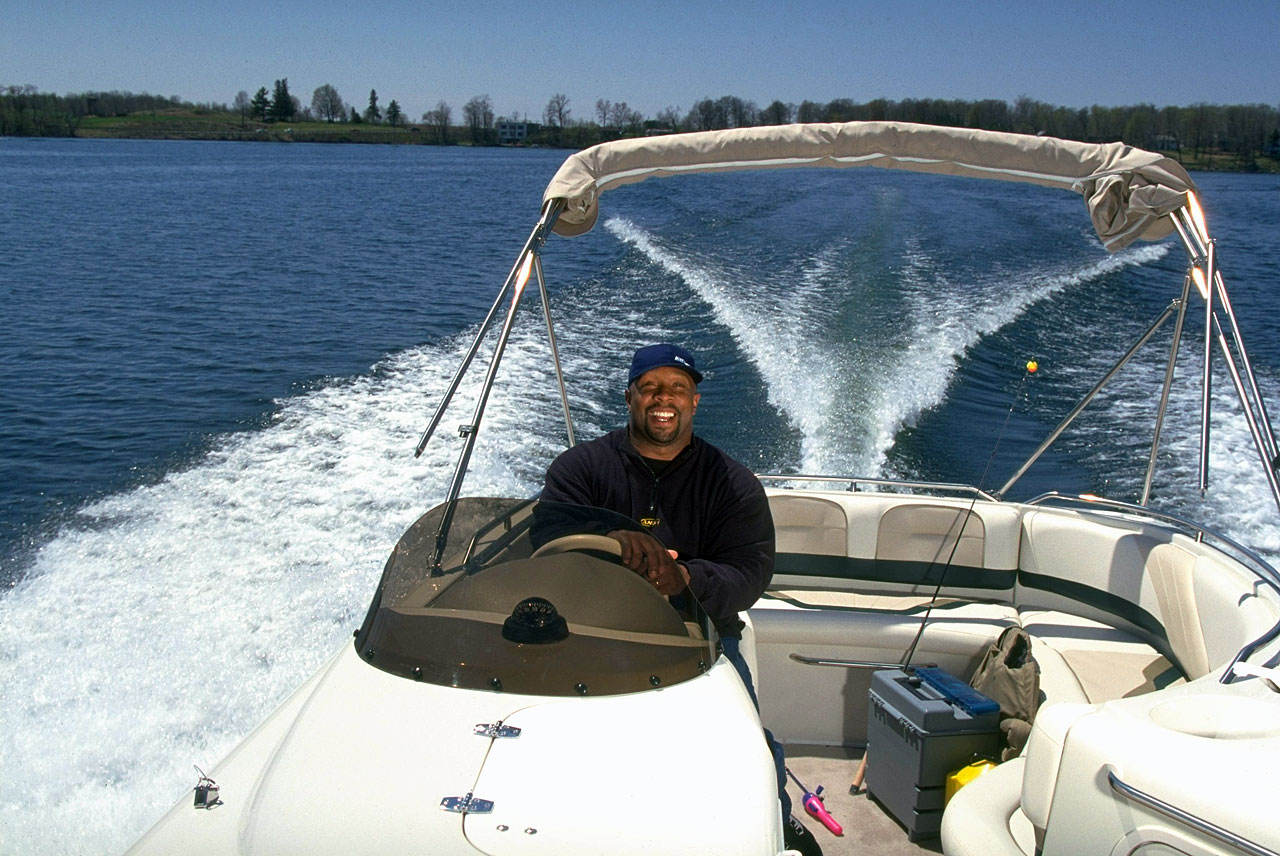 Kirby Puckett smiles while steering his fishing boat.
