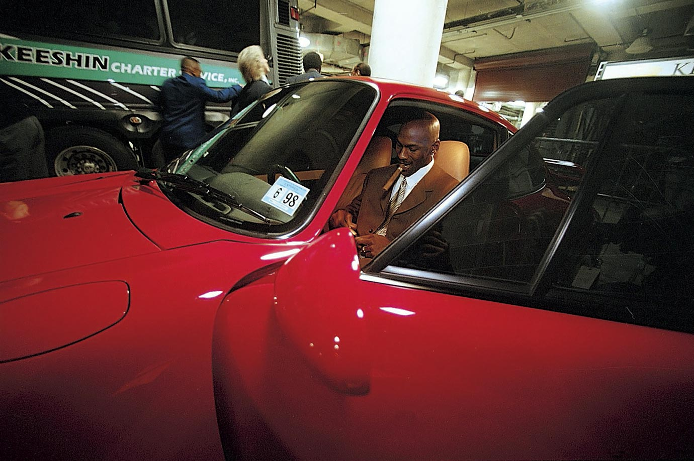 Michael Jordan readies a cigar in his Porsche after a home game in 1998.