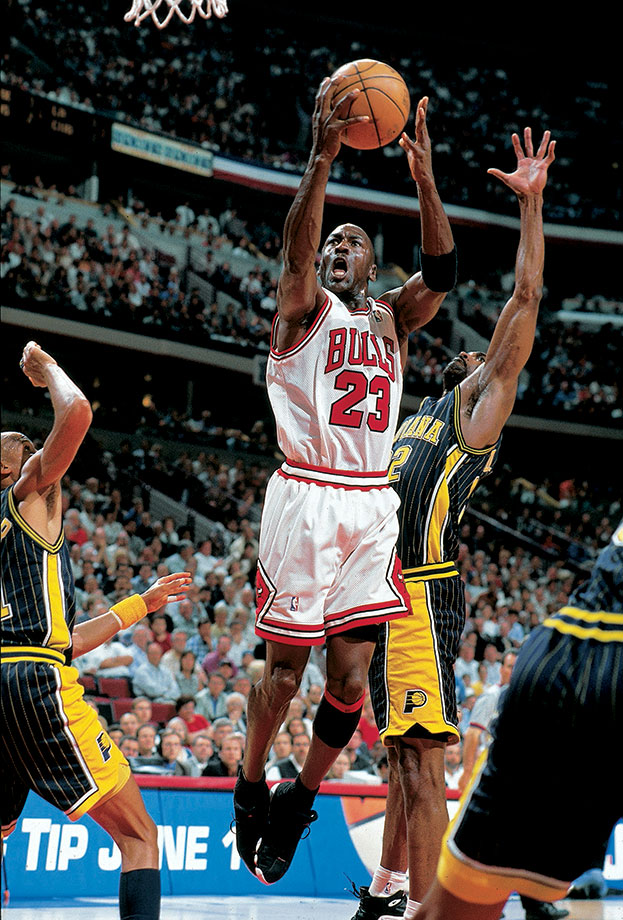 Michael Jordan splits a double team to get a shot off against the Indiana Pacers in Game 2 of the 1998 Eastern Conference Finals. Jordan dominated the Pacers to will the Bulls to a victory, scoring 41 points with five assists, four rebounds and four steals. Chicago won the series in seven games.