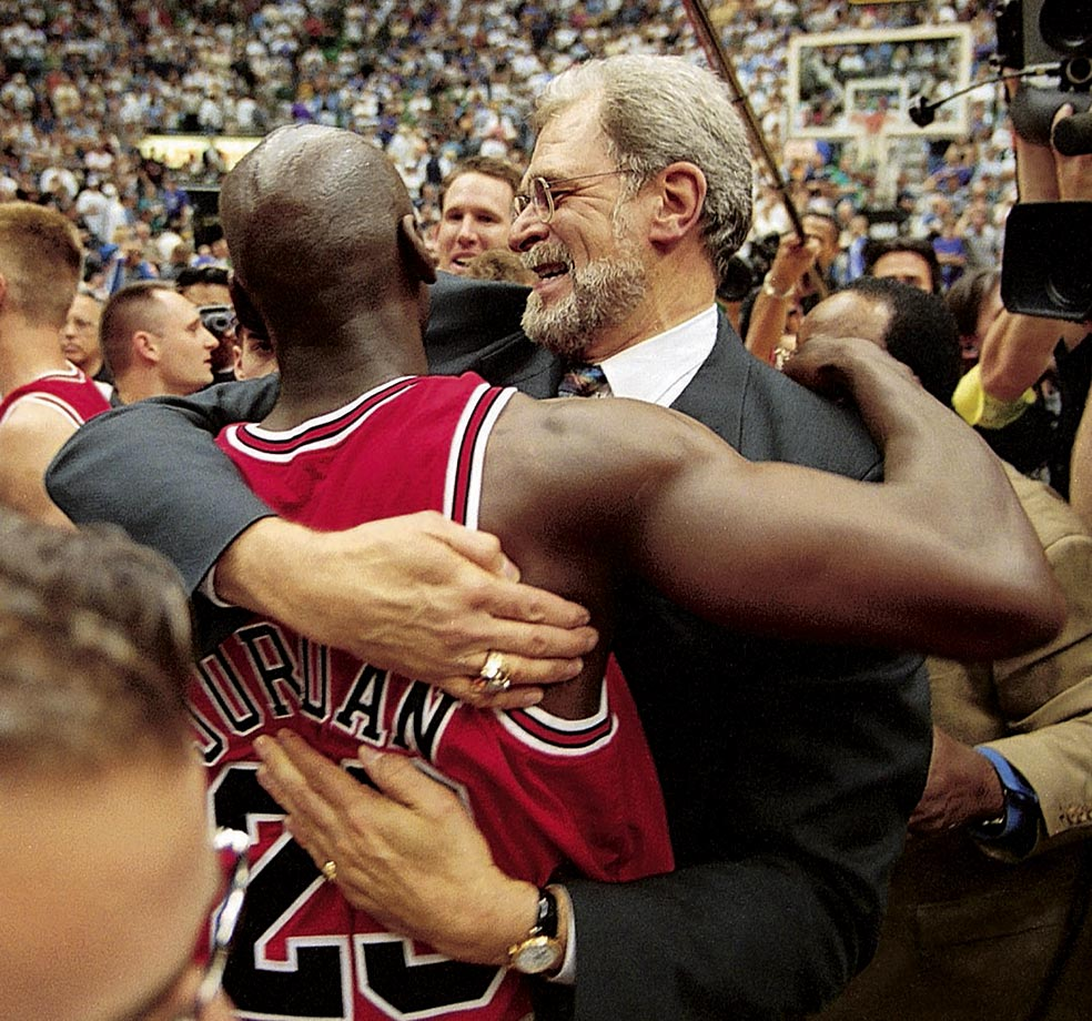 Michael Jordan hugs Phil Jackson after winning the 1998 NBA Finals over the Utah Jazz. The championship victory was the last time either would represent the Chicago Bulls as Jordan retired for a second time after the season and Jackson took a year off from coaching before taking over the Los Angeles Lakers.