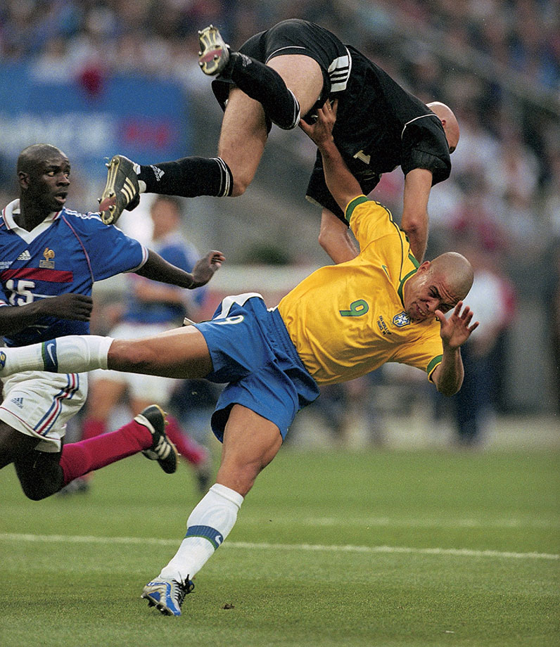 French goalkeeper Fabien Barthez charges into Ronaldo during the 1998 World Cup final between France and Brazil. France won 3-0.