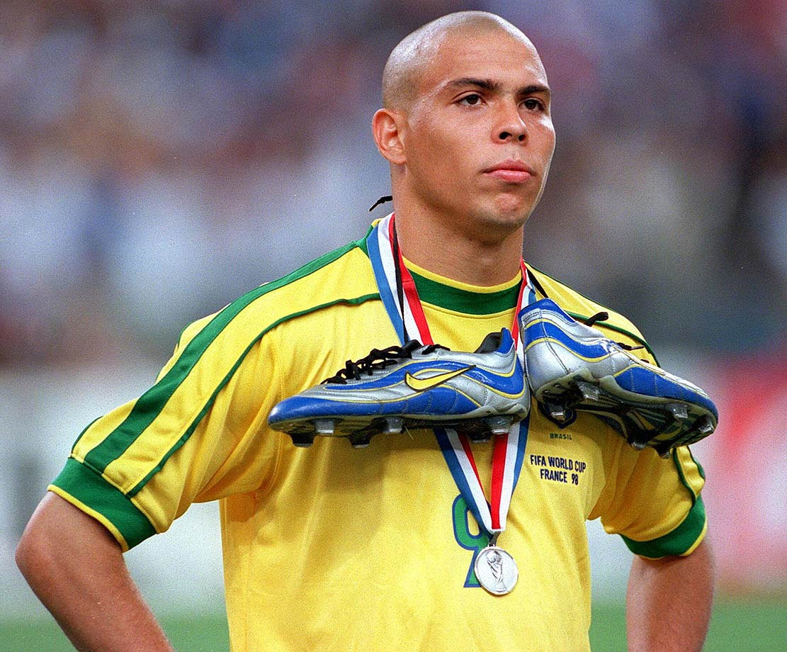 Ronaldo stands dejected after the 1998 World Cup final with his silver medal.