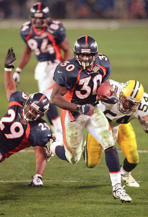 Denver Broncos running back Terrell Davis rushes past Green Bay Packers linebacker Seth Joyner. Davis missed most of the second quarter with a migraine but still rushed for 157 yards with three touchdowns to earn Super Bowl MVP in Denver's 31-24 victory.