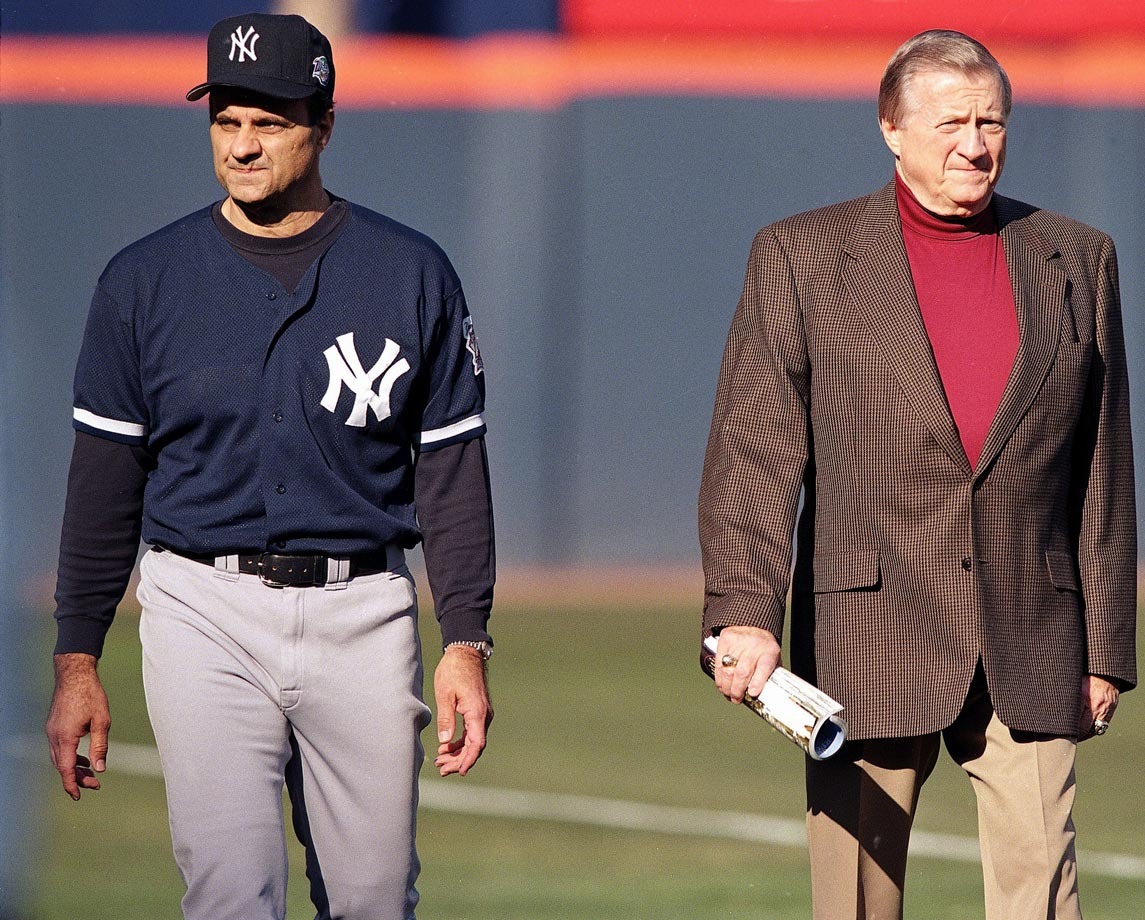 New York Yankees manager Joe Torre and George Steinbrenner walk on the field before Game 3 of the World Series against the San Diego Padres on Oct. 20, 1998 at Qualcomm Stadium in San Diego.