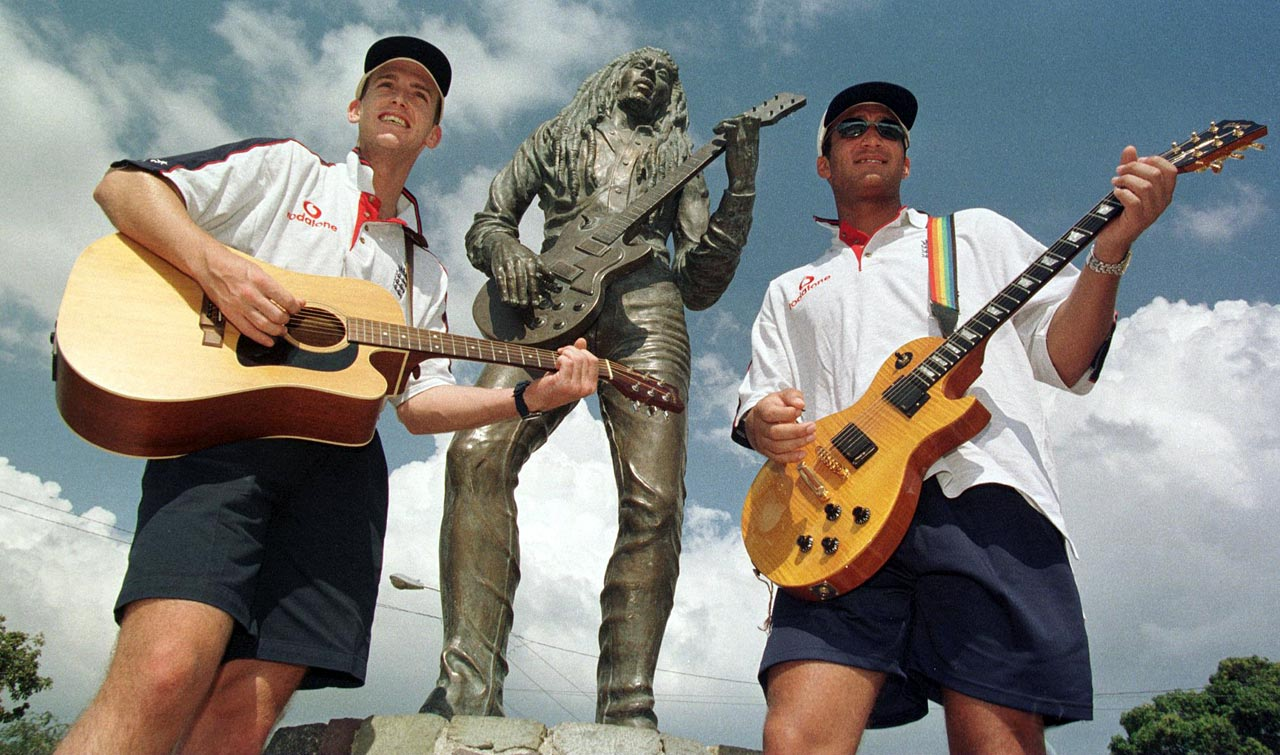 John Crawley and Mark Butcher of the England cricket team play guitar in front of the legendary Bob Marley statue in Kingston, Jamaica, on Jan. 13, 1998.
