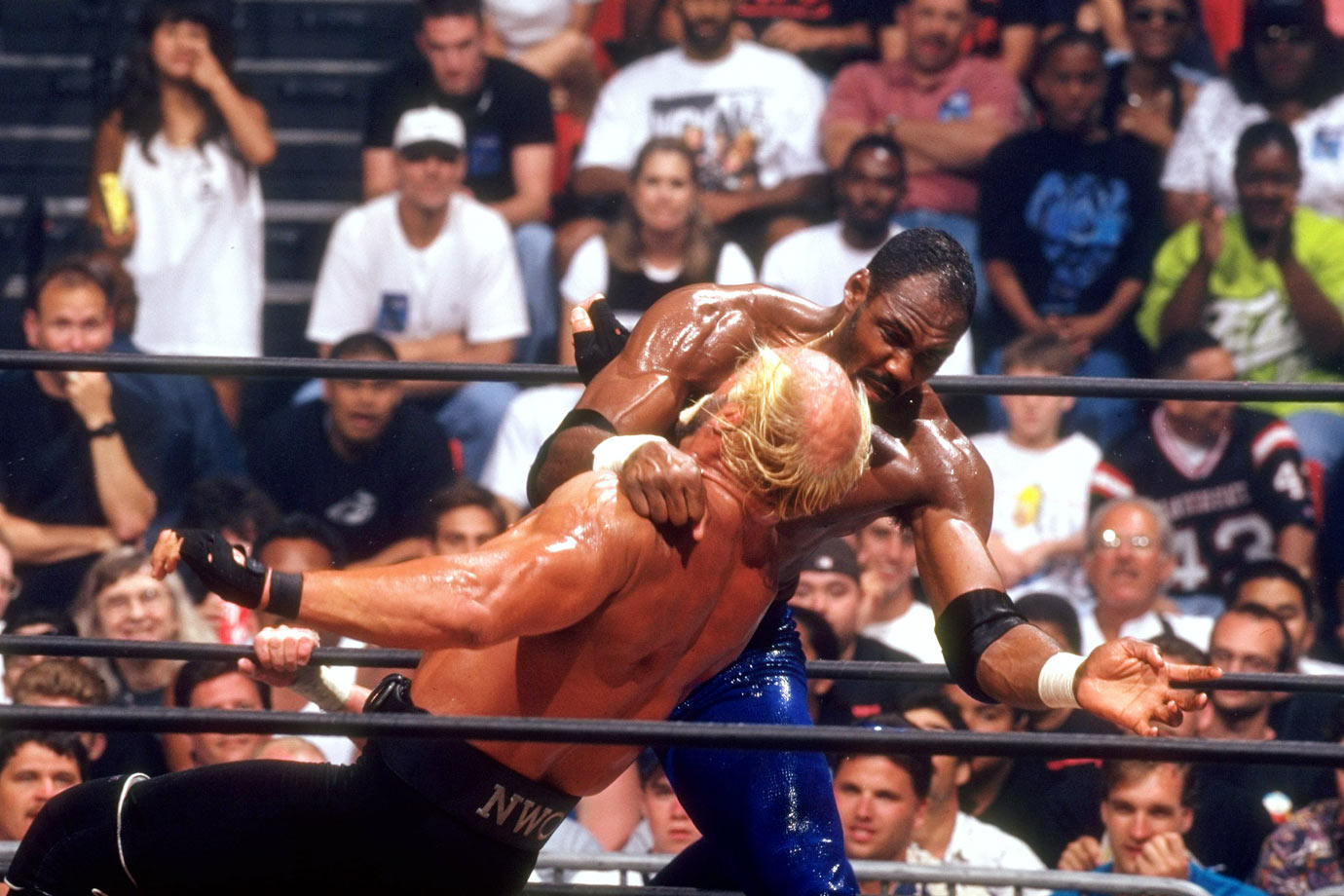 Karl Malone delivers a clothesline to 'Hollywood' Hulk Hogan during the WCW Bash at the Beach.