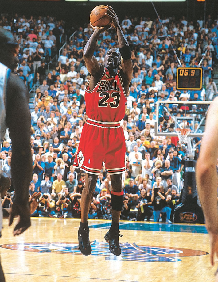 Michael Jordan pulls up for his game-winning jumper to beat the Utah Jazz in Game 6 of the 1998 NBA Finals and clinch the championship. Jordan shook loose from defender Bryon Russell to nail the shot, his final in a Bulls' uniform.