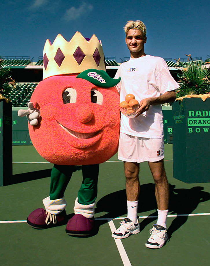 A 17-year-old Roger Federer poses with Obie, the Orange Bowl mascot, after winning the boys' singles title at the Orange Bowl in Miami on Dec. 20, 1998.