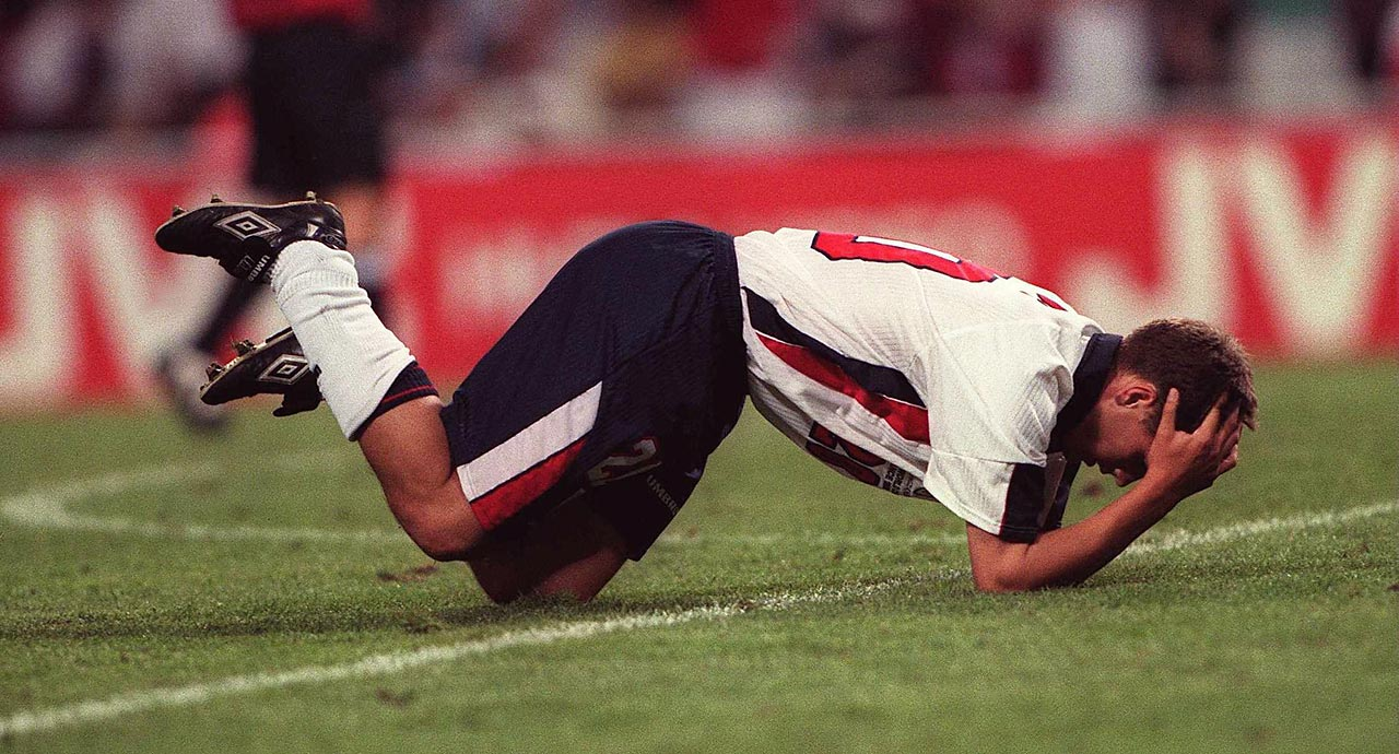 Michael Owen of England collapses and holds his head in his hands after England loses, 2-1, to Romania in their first-round match in the 1998 World Cup.