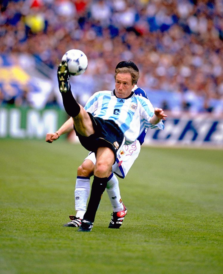 Argentinian defender Roberto Sensini kicks the ball away from Japan's Hiroshi Nanami with a sensational bicycle kick clearance during their Group H matchup in the 1998 World Cup.                                 (Shot with Canon EOS-1D Mark III)