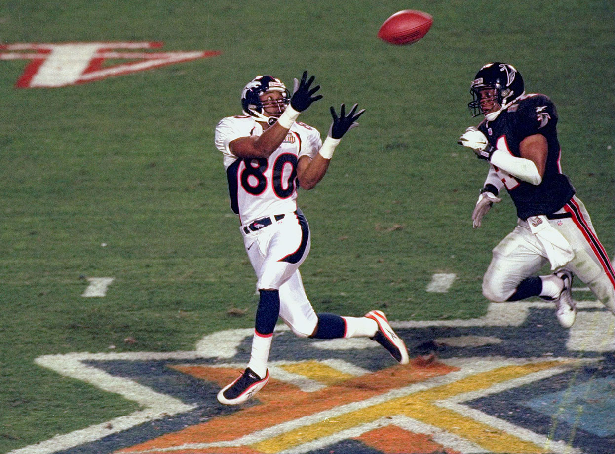 Denver Broncos wide receiver Rod Smith awaits a bomb from John Elway after gaining separation from Atlanta Falcons free safety Eugene Robinson. Smith took the ball for an 80-yard touchdown to expand Denver's lead to 14 points in the second quarter. They went on to win 34-19.