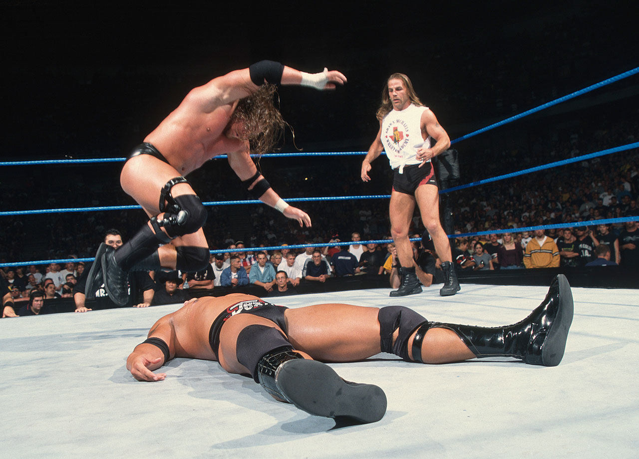 On the official SmackDown premiere, WWE Champion Triple H defeats The Rock with the help of special guest referee Shawn Michaels.