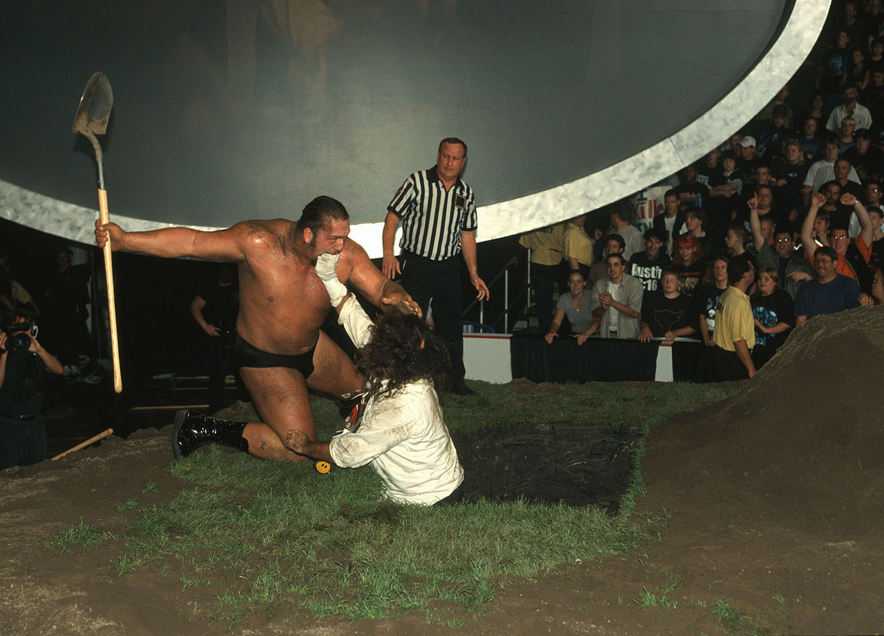 The Undertaker and Big Show defeat The Rock N' Sock Connection (The Rock and Mankind) in a Buried Alive Match to become World Tag Team Champions.