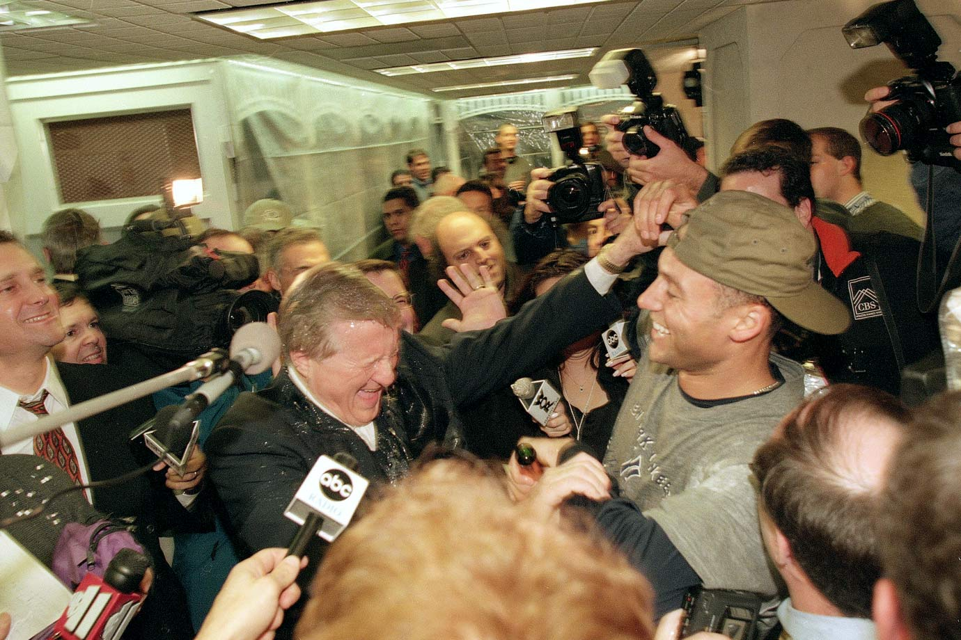George Steinbrenner laughs with Derek Jeter after Jeter poured champagne on him after the New York Yankees World Series sweep of the Atlanta Braves on Oct. 27, 1999 at Yankee Stadium in Bronx, N.Y.
