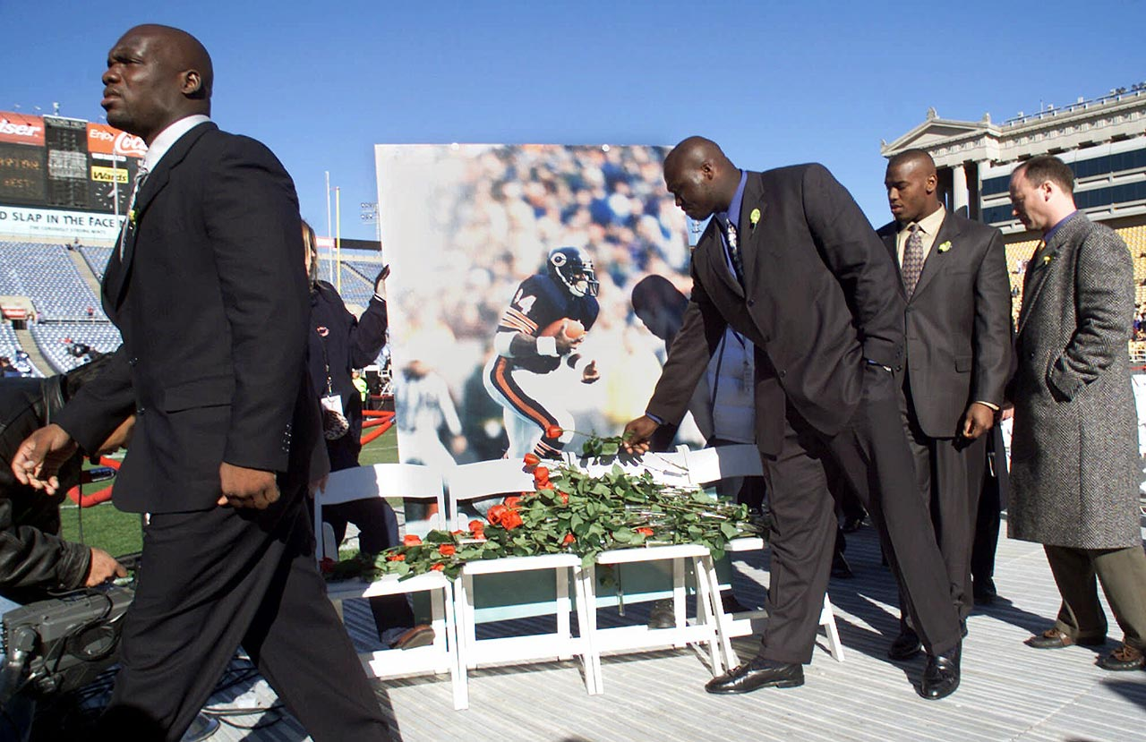 Chicago Bears players lay roses in front of a picture of Walter Payton as they leave a memorial service for the former football great on Nov. 6, 1999 in Chicago.  Payton died five days earlier at age 45.