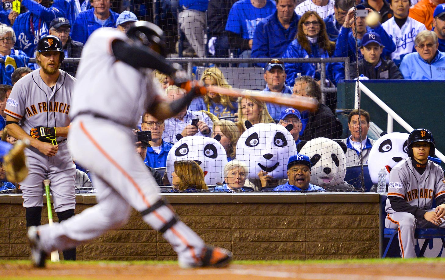 The pandas watch San Francisco Giants third baseman Pablo Sandoval in the first inning.