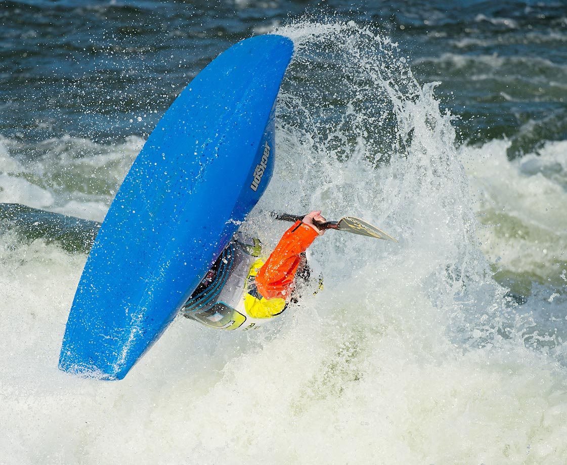 Four-time world champion Eric Jackson finishes off a front loop during the 2014 Payette River Games in Cascade, Idaho.  Fun Fact: Eric also designs and builds most of the boats in the competition.