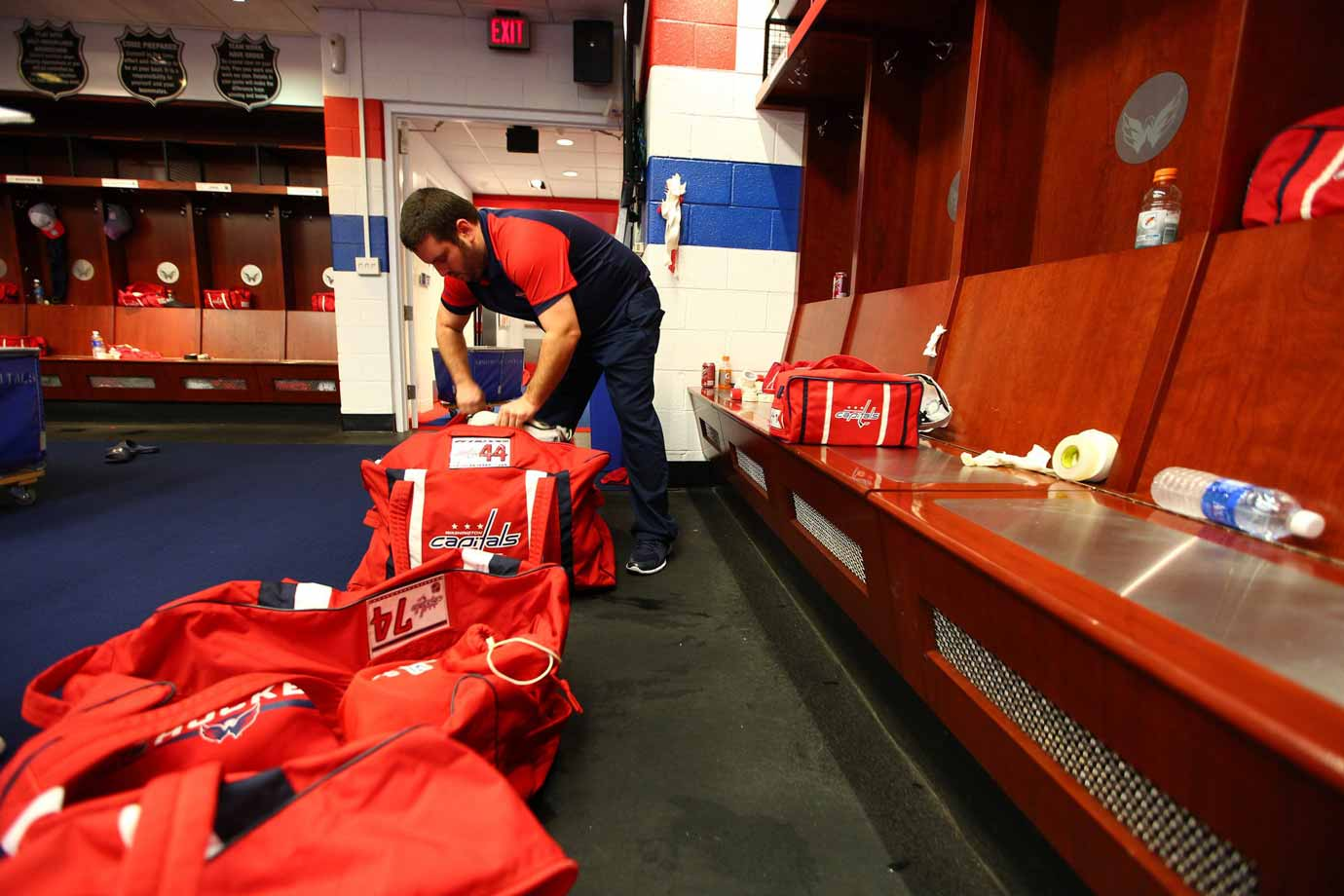 While the players dress and clear out, the Capitals equipment management staff swings into action, packing gear and fresh uniforms for the next night's game in Toronto.