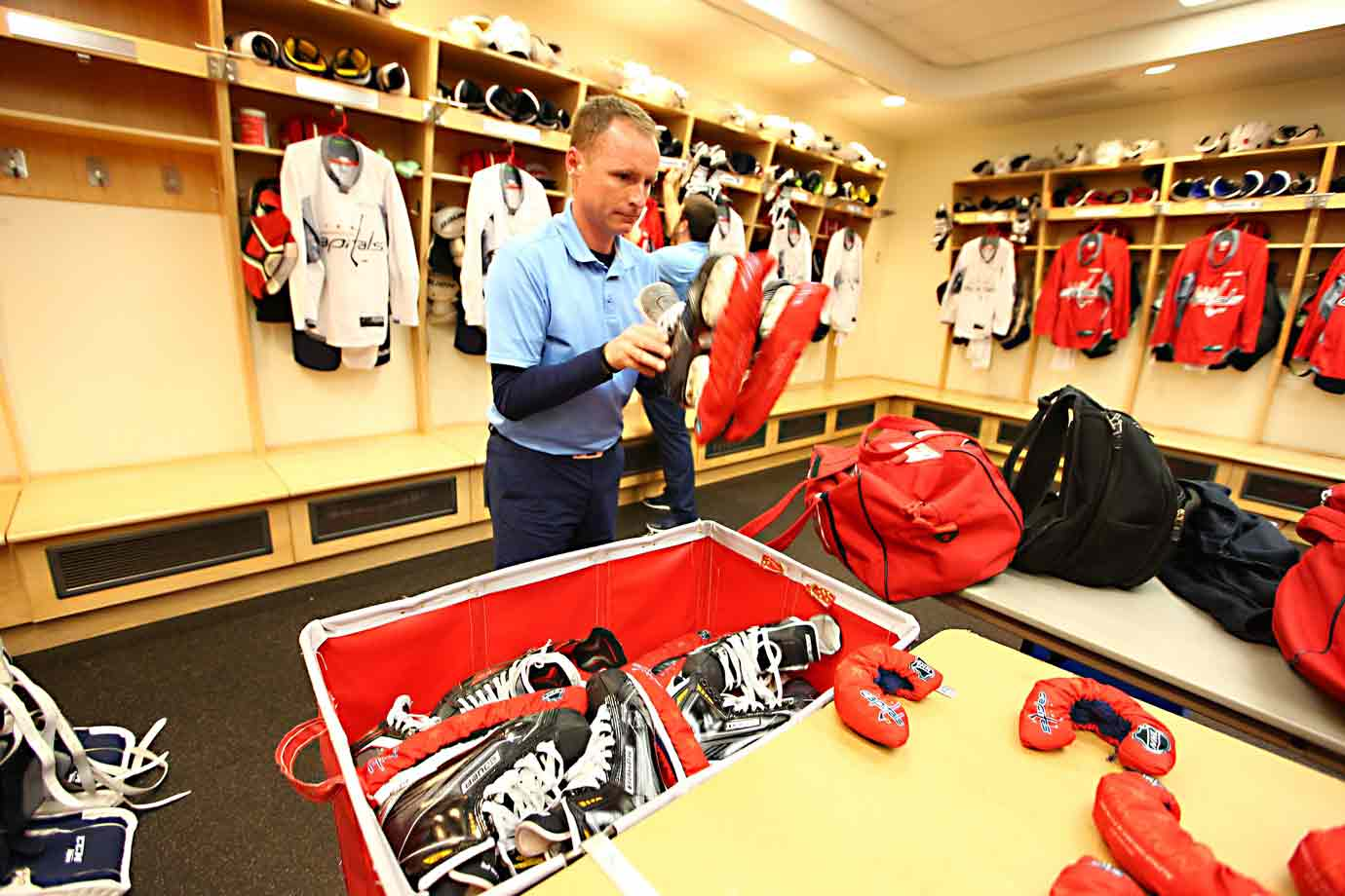 Equipment manager Brock Myles tends to the skates.