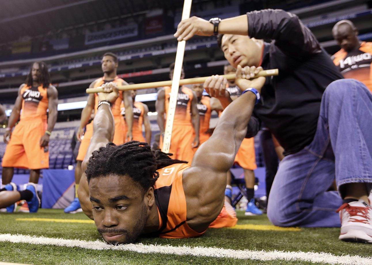 Connecticut wide receiver Geremy Davis is measured for flexibility at the scouting combine in Indianapolis.