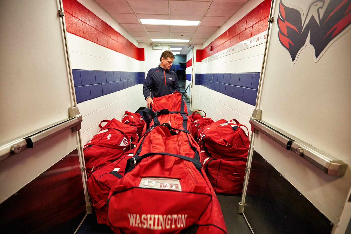 At 7:53 equipment manager Craig Leydig hauls the bags down the hall, out the arena's back exit and to a waiting box truck. In all, 2,770 pounds of gear will make the trip.