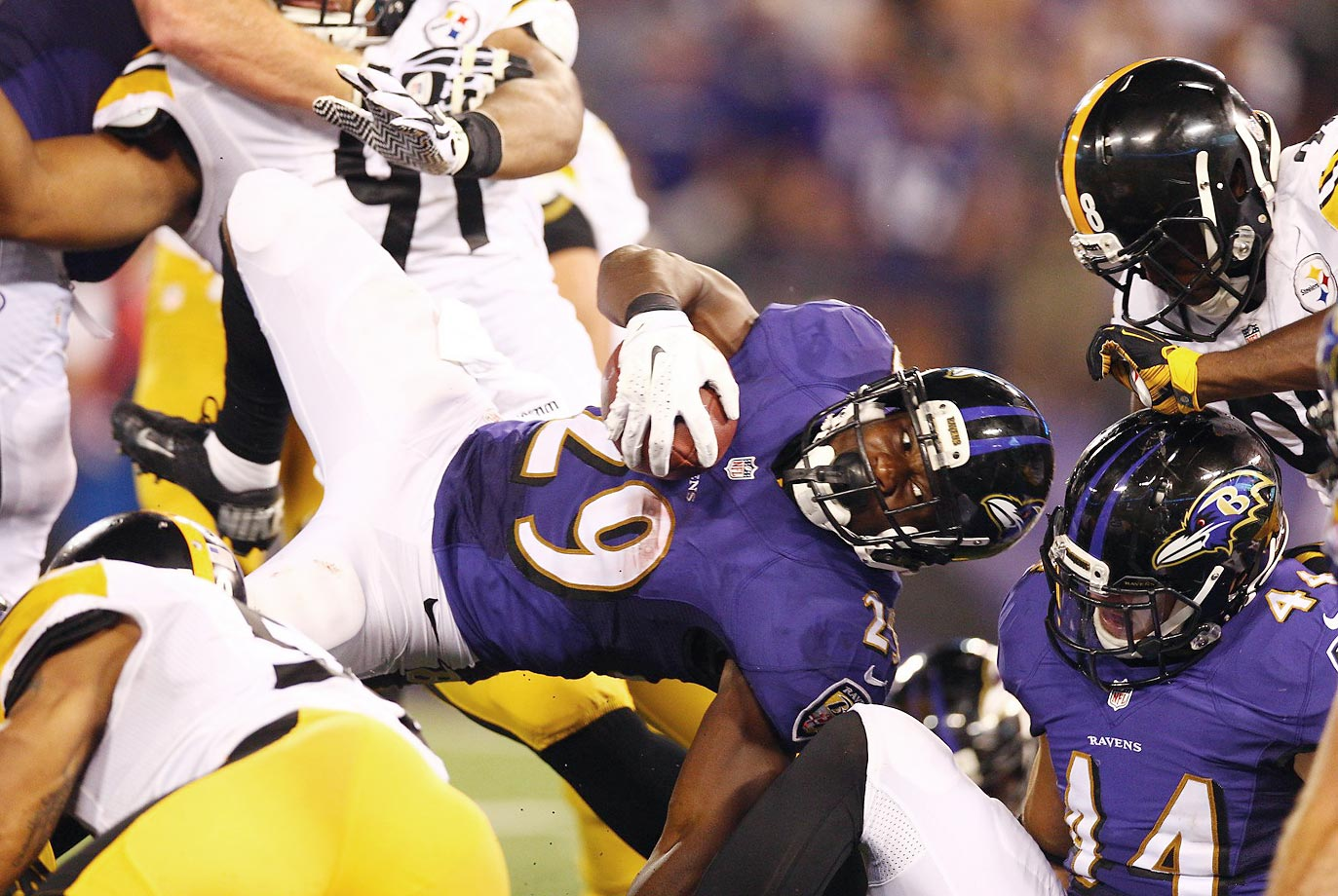 Ravens running back Justin Forsett attempts to drive in for a touchdown against the Steelers.