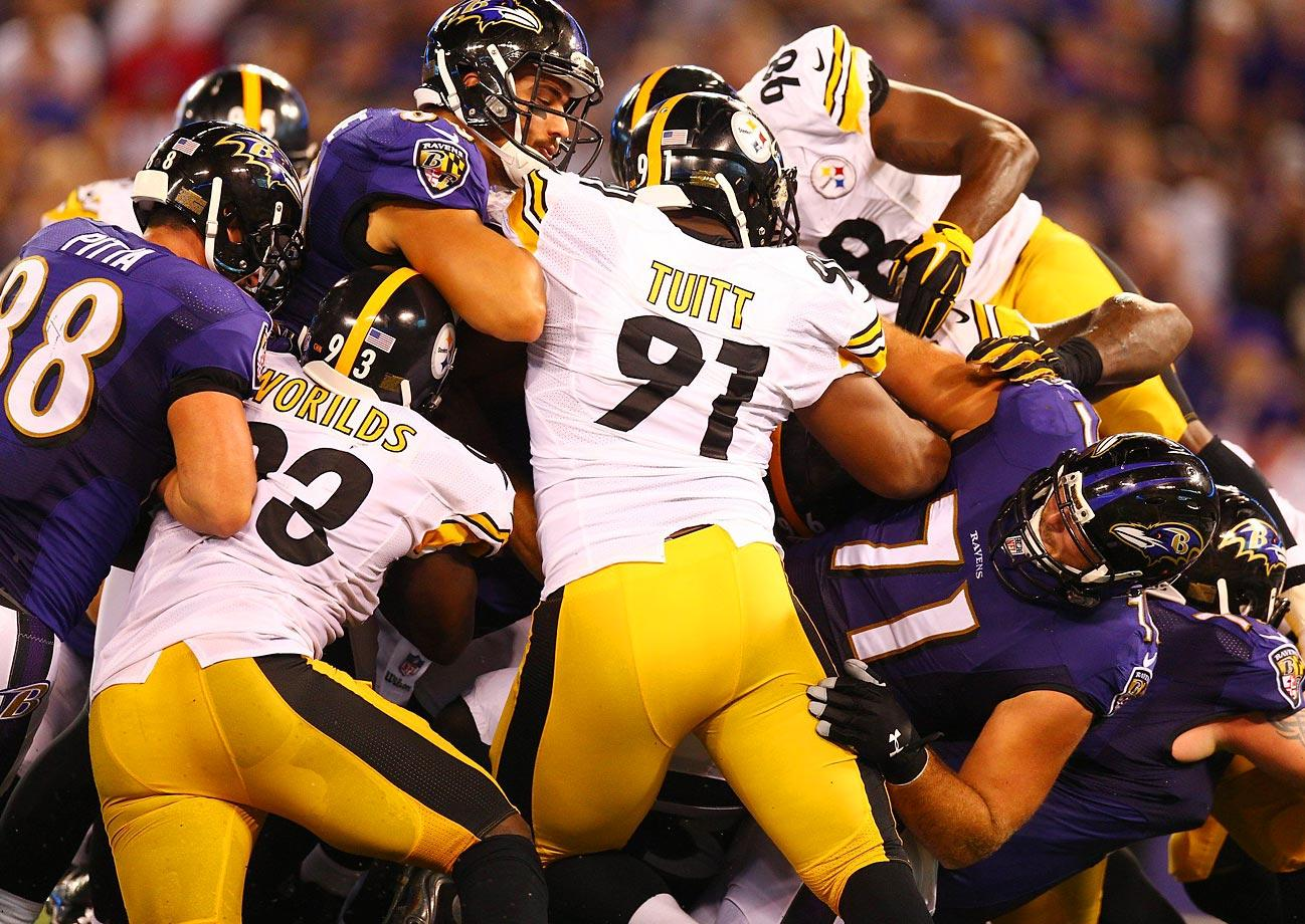 The Ravens and Steelers pile up at the line of scrimmage during their matchup.