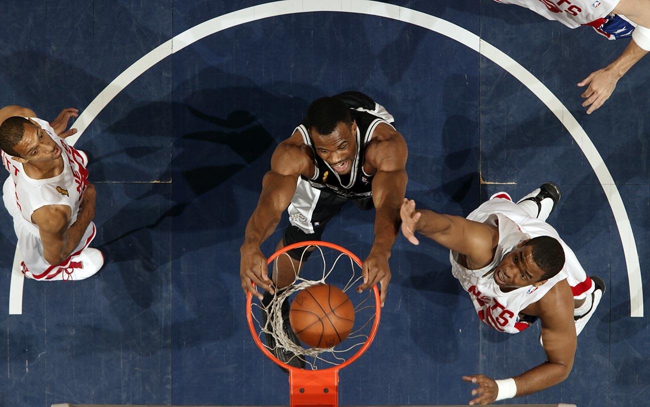 David Robinson of the Spurs dunks on Jason Collins of the Nets in Game 5. San Antonio took the series in six games, with Robinson teaming up with the core of Tim Duncan, Tony Parker and Manu Ginobili winning their first title together.