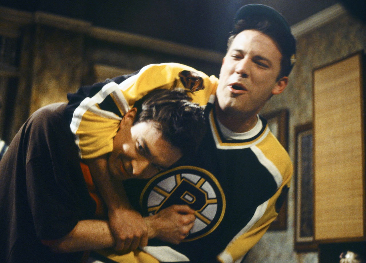 "Ben Affleck, wearing a Boston Bruins jersey, goofs around with Jimmy Fallon on the set of ""Saturday Night Live"" on Feb. 19, 2000 in New York City."