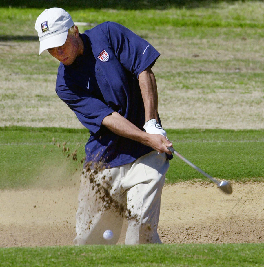 Landon Donovan hits out of a bunker while playing a round of golf in Adelaide, Australia, on an off-day before playing Japan in one of the quarterfinal matches of the Olympics.