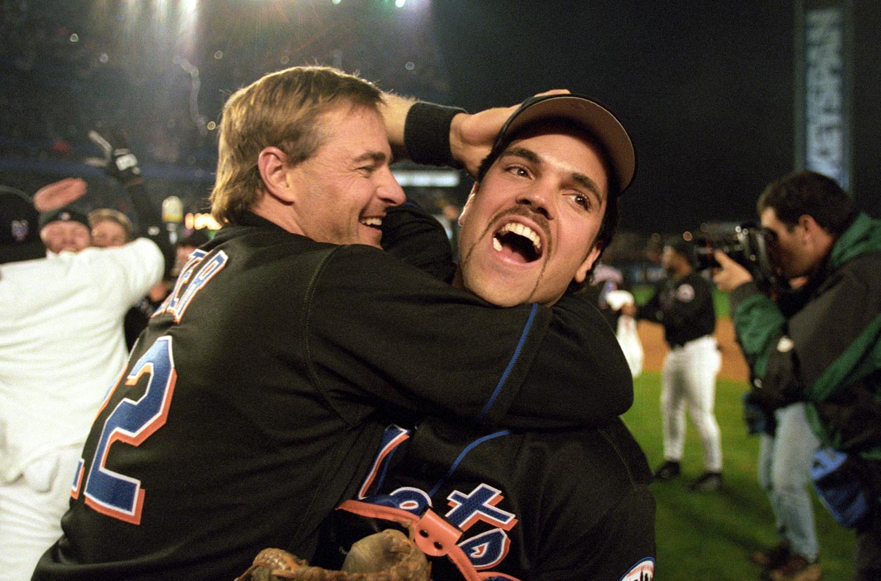 Al Leiter and Mike Piazza celebrate after winning Game 5 of the 2000 NLCS against the Cardinals.