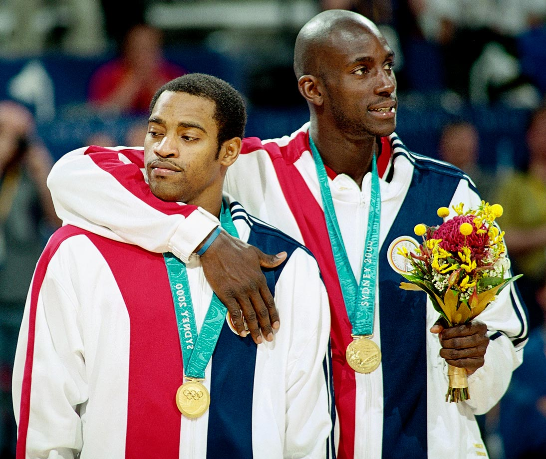 Kevin Garnett puts his arm around Vince Carter after leading Team USA to the gold medal in Sydney.