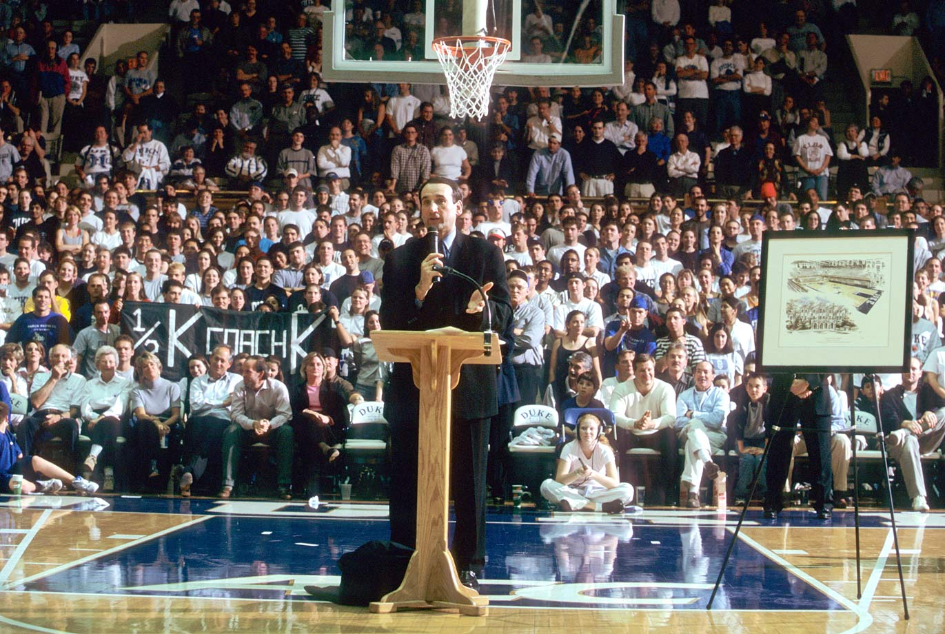 Mike Krzyzewski speaks from a podium after Duke's 98-85 win over Villanova for his 500th career victory at Cameron Indoor Stadium in 2000. Krzyzewski won the game on the day that Coach K Court was unveiled.