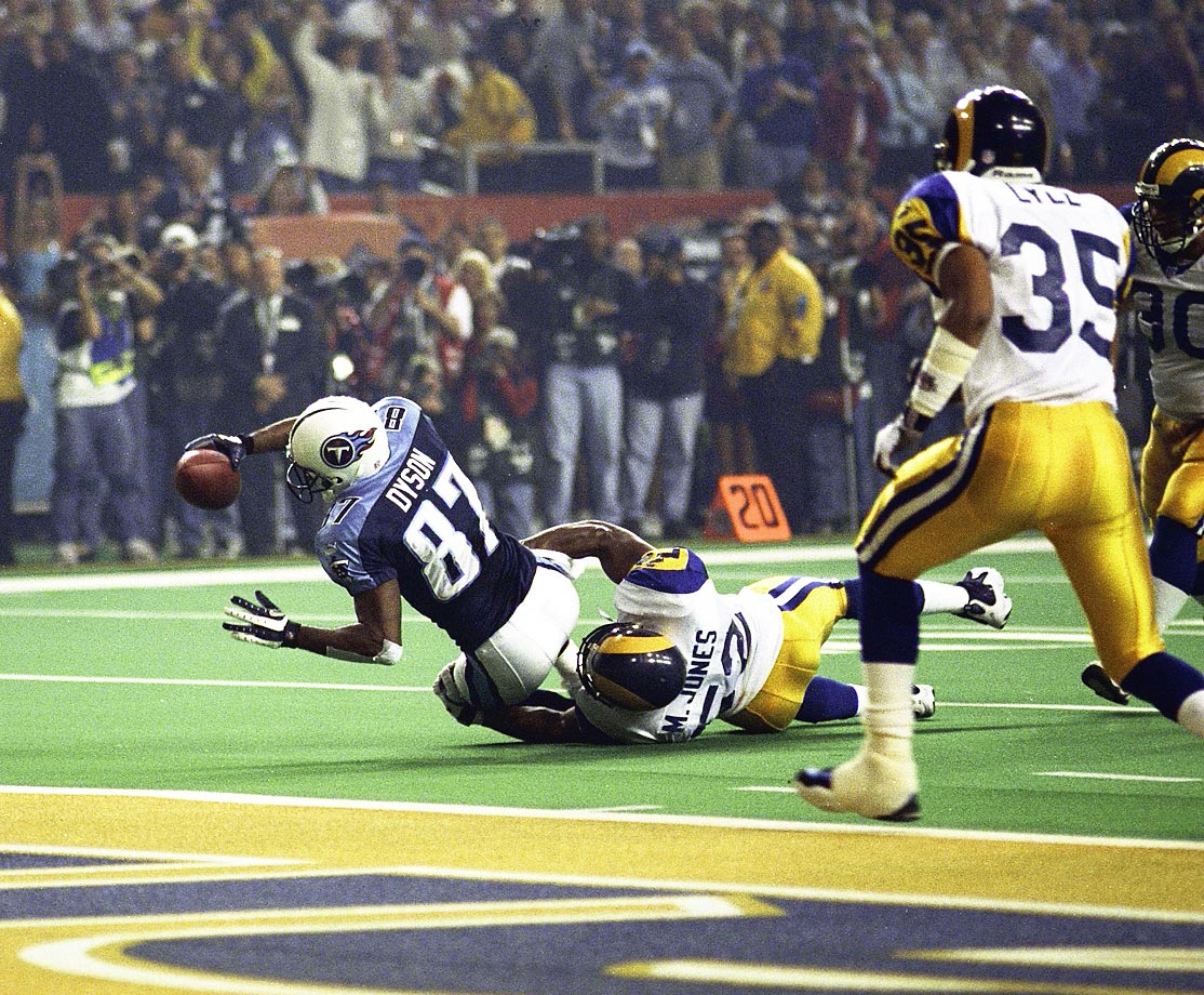 Kevin Dyson of the Tennessee Titans comes up short in his bid to score the winning touchdown as Mike Jones makes the tackle for the St. Louis Rams.