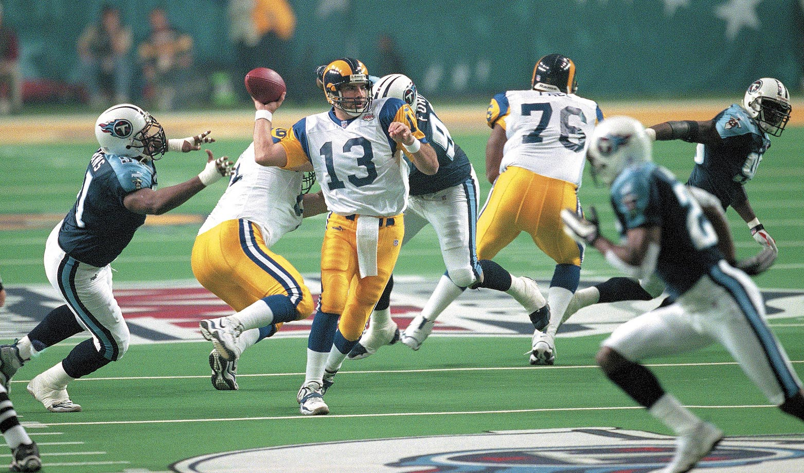 MVP Kurt Warner set Super Bowl records by passing for 414 yards and attempting 45 throws without an interception.