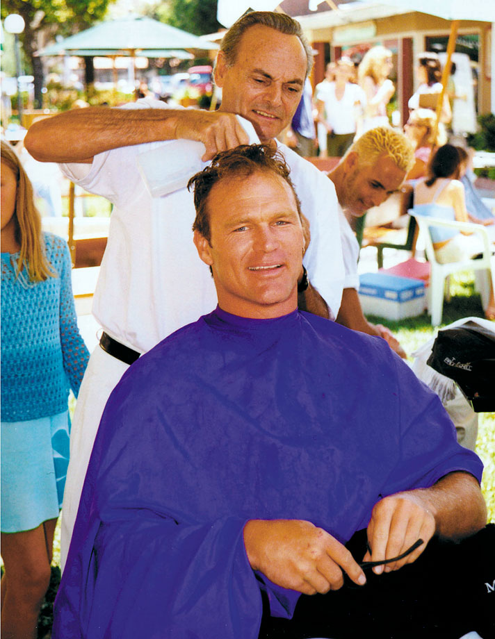 Bosworth receives a haircut from a hairstylist at the Parkinson Institute Benefit Cut-A-Thon in Malibu, Calif.