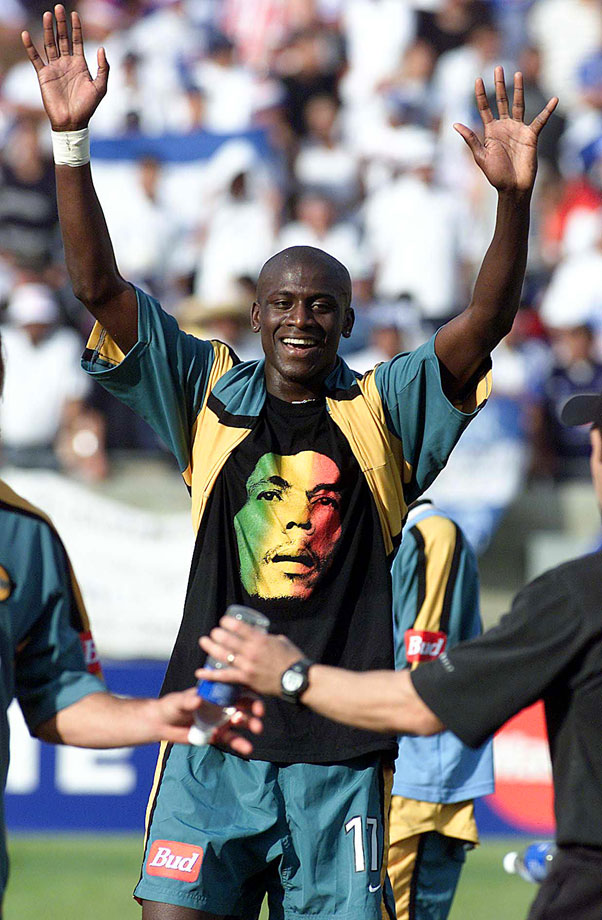 LA Galaxy midfielder Ezra Hendrickson shows off his Bob Marley t-shirt as he celebrates his team's 3-2 win over the Honduran squad CD Olimpia in the Champions Cup final in Los Angeles on Jan. 21, 2001.  Hendrickson scored two of the Galaxy's three goals in the victory.