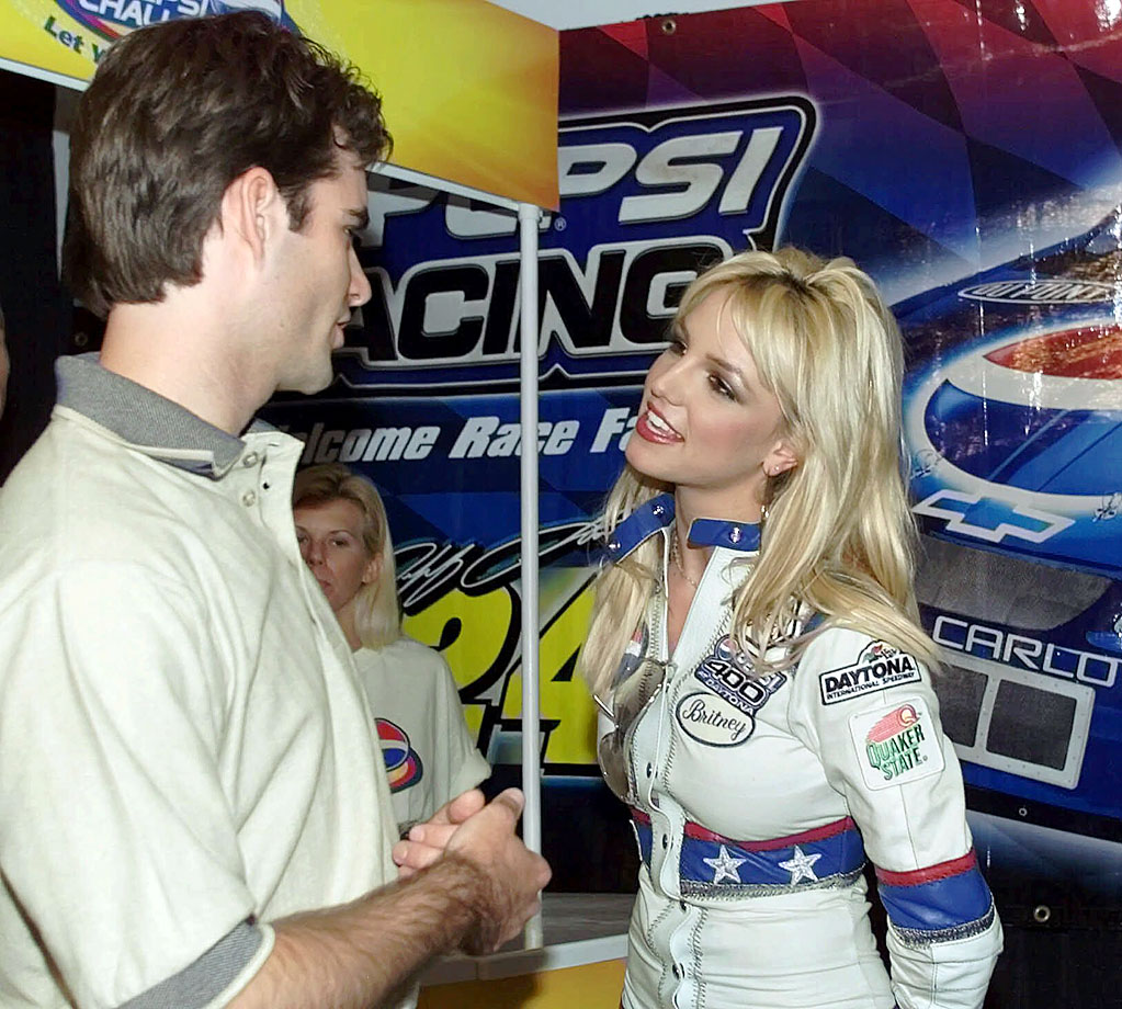 Jeff Gordon chats with Britney Spears, the grand marshall for the Pepsi 400 NASCAR race at Daytona International Speedway.