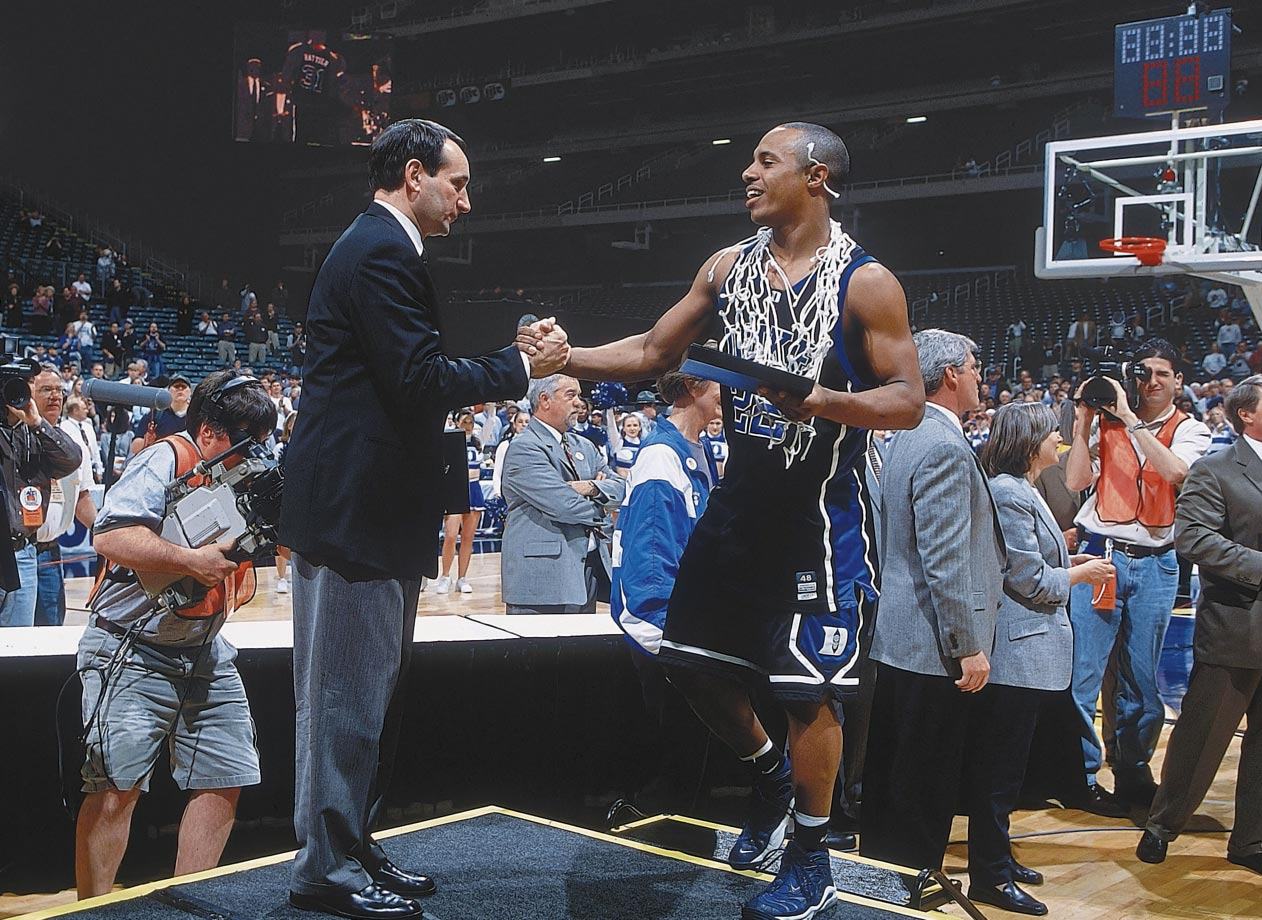 Mike Krzyzewski and Jason Williams