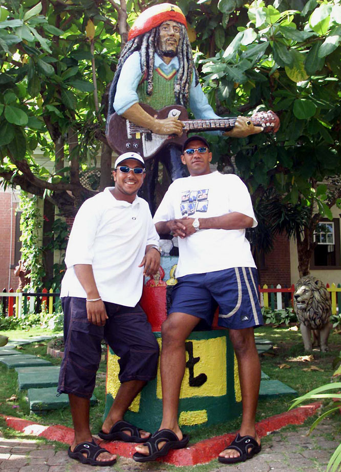 South African cricketers Paul Adams and Roger Telemachus pose outside the Bob Marley museum in Kingston, Jamaica, on April 26, 2001.