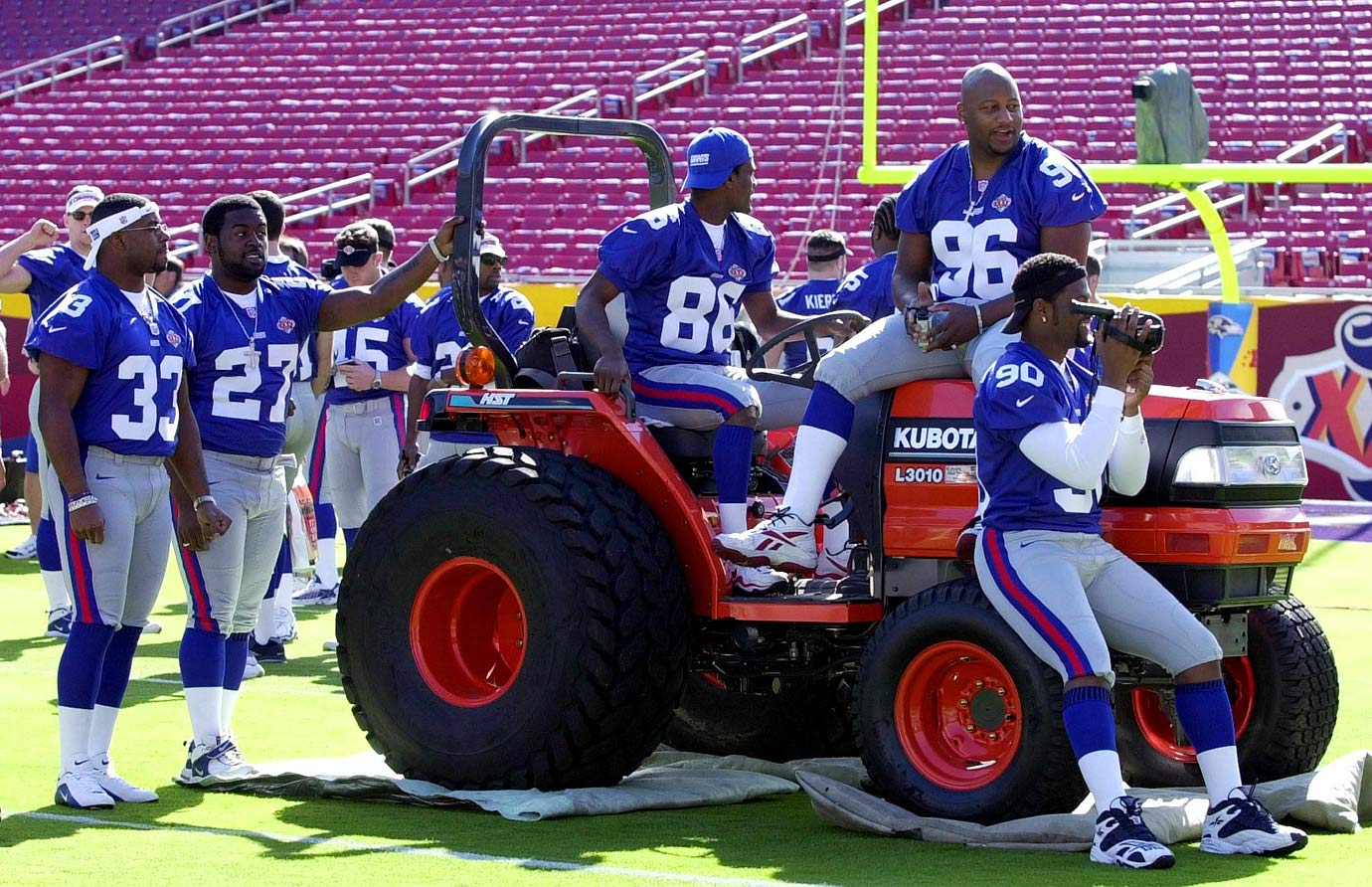 Members of the New York Giants play around on a tractor during Super Bowl XXXV Media Day in Tampa. The Giants wound up going home disappointed as they were beaten by the Ravens, 34-7.